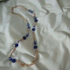 Double strand gold  tone necklace with blue beads